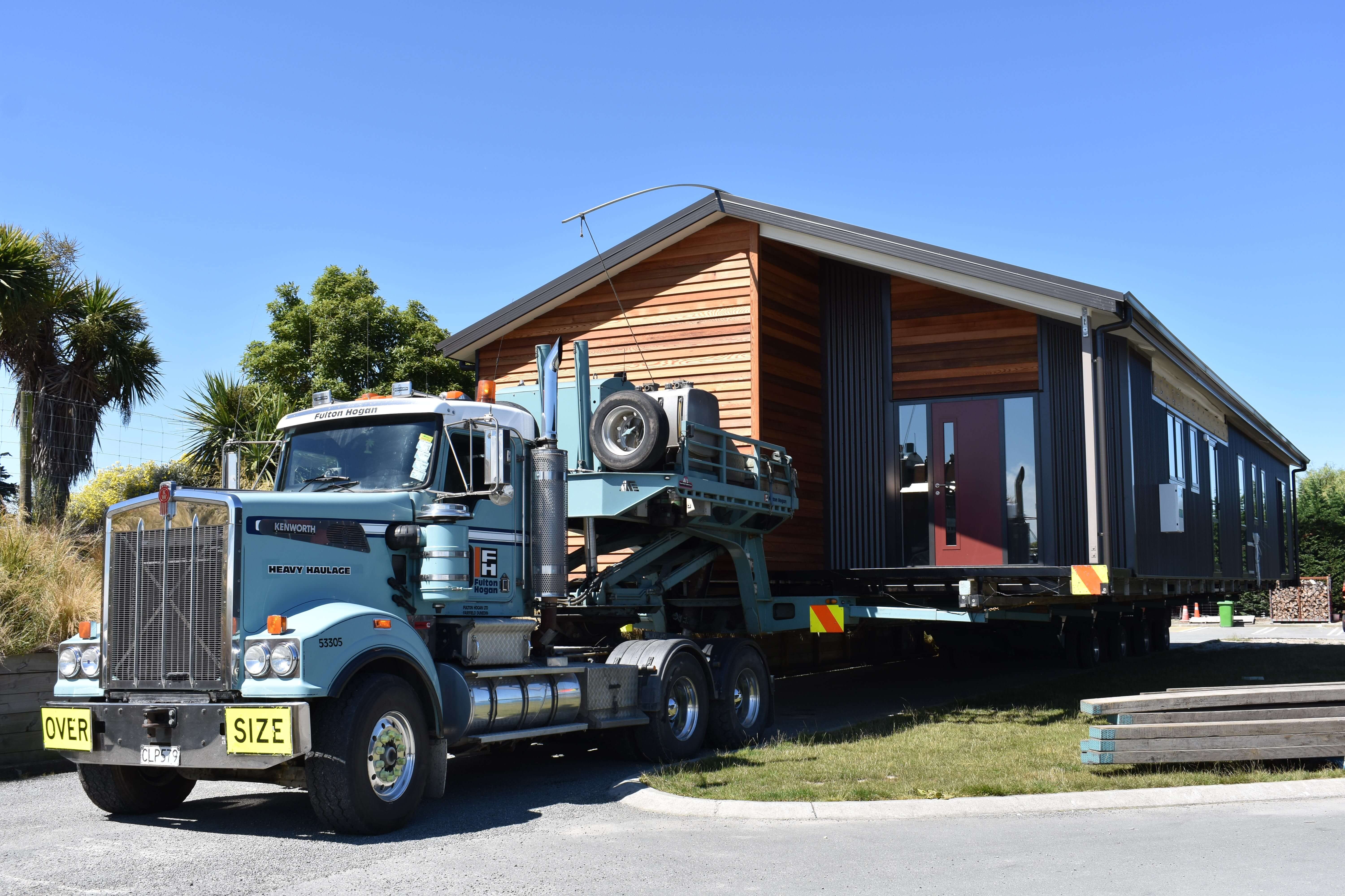 A prefab second dwelling being delivered