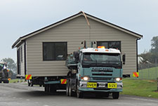 House being transported to its final destination by Genius Homes