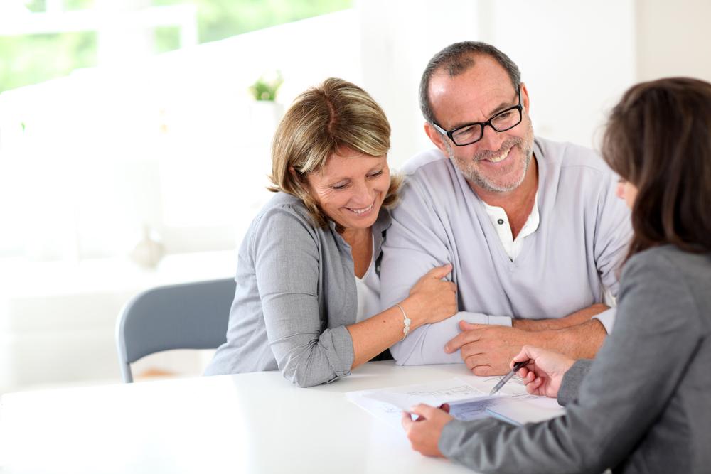 Couple discussing their dream prefab home plan